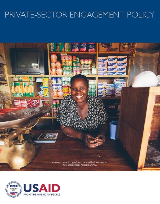 Document cover page featuring a photo of a woman behind the counter of a store