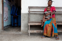 First page of DRC Country Case Study. Photo of woman with young child in lap.